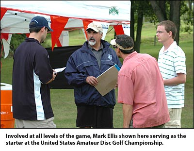 Involved at all levels of the game, Mark Ellis shown here serving as the starter at the United States Amateur Disc Golf Championship